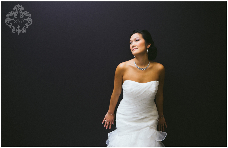 bride leaning against a wall