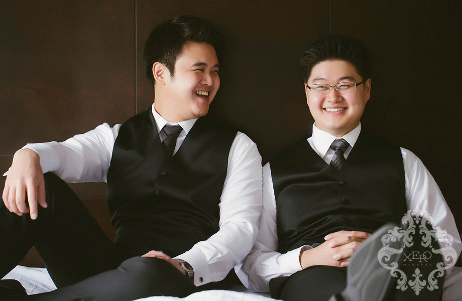 groom and his brother laughing