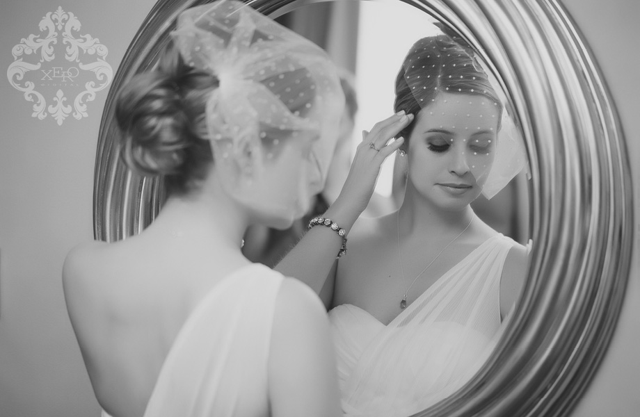 bride photographed in mirror by wedding photographers Toronto