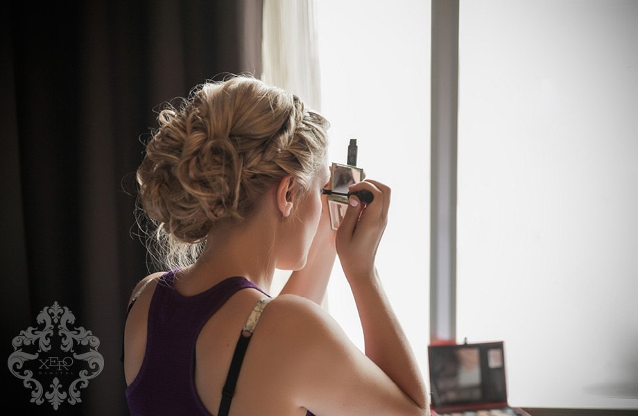 bridesmaid putting on makeup