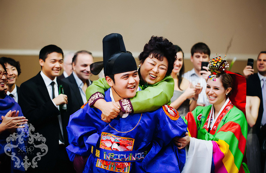 groom with his mom on his back