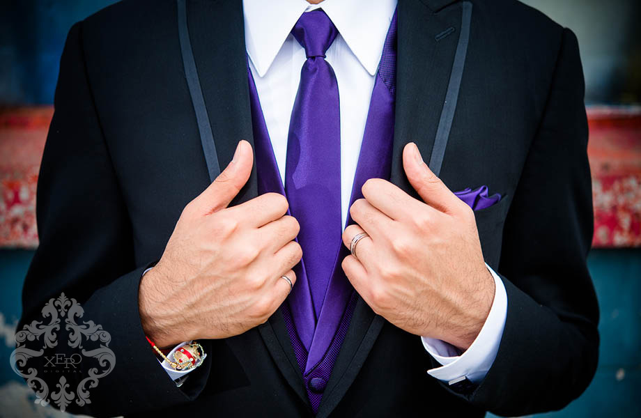 groom's suit and purple tie