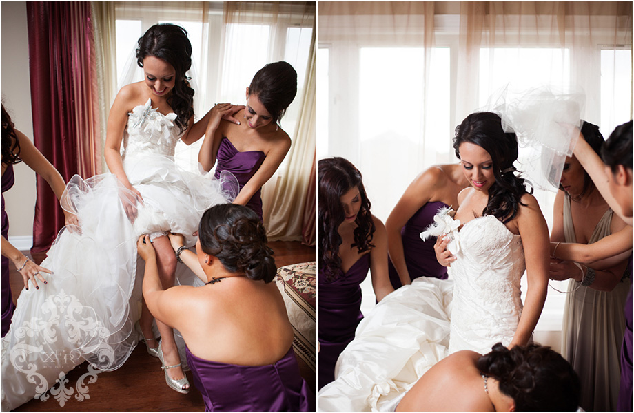 girls helping bride into dress