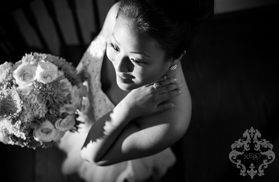 black and white photo of bride going down the stairs