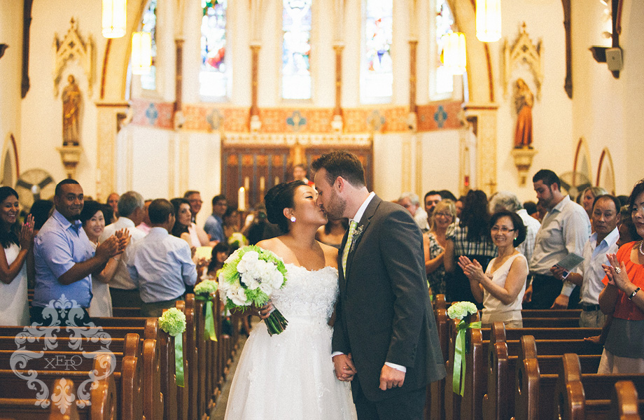 kissing at the end of the aisle