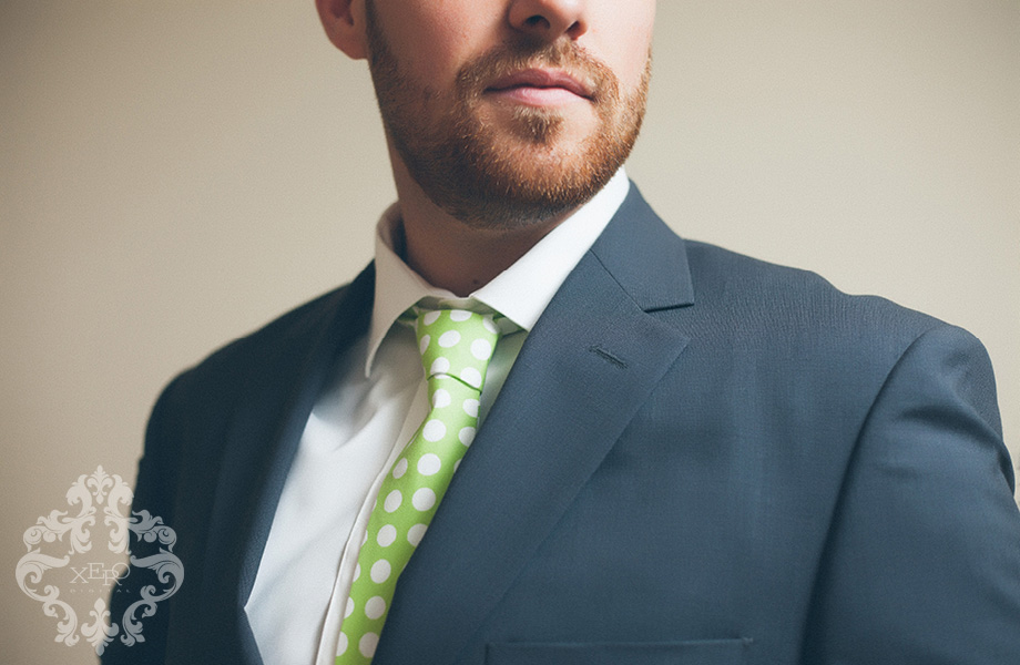 groom in suit and green tie