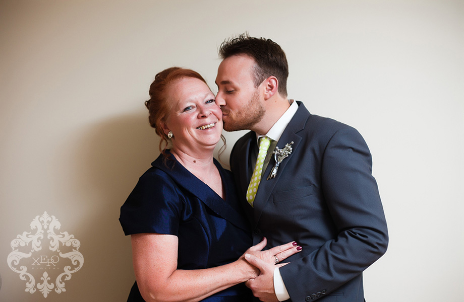 groom kissing his mother on the cheek