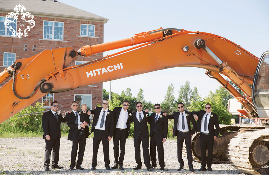 manly groomsmen shot with a tractor